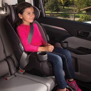 little girl sitting on right baby car seat